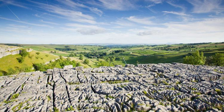 Cracks in limestone, under a hazy blue sky