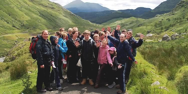 Group of school children on a fieldtrip amongst mountains