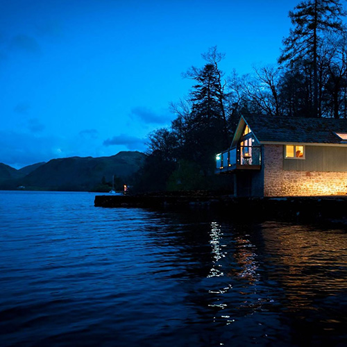 A Sykes Holiday Cottage overlooking a lake in the Lake District National Park