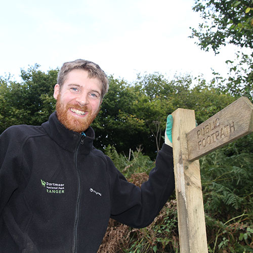 Ranger and a public footpath signpost