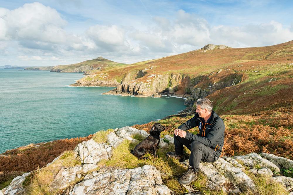 A ranger overlooking a rocky coastline